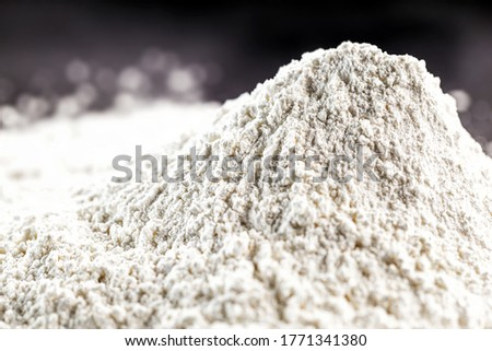Kaolin is a mineral of inorganic constitution, chemically inert, extracted from deposits and processed in different granulometric bands. Used in the food, paper and paints industry Royalty-Free Stock Photo #1771341380