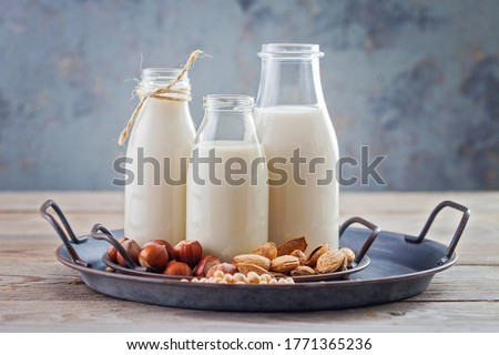 various vegan plant based milk and ingredients - food and drink Royalty-Free Stock Photo #1771365236