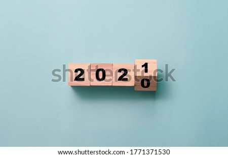 Flipping of wooden cubes block to change 2020 to 2021 year. Merry Christmas and happy new year concept. #1771371530