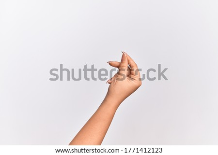 Hand of caucasian young woman holding blank space with thumb finger, business and advertising