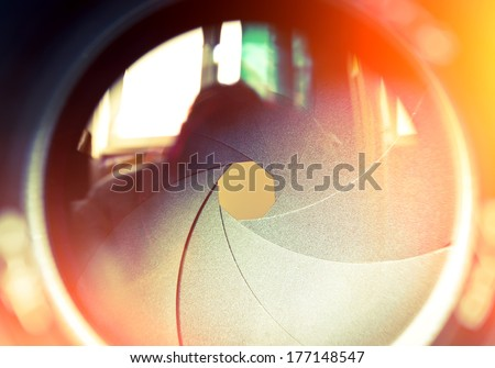 The diaphragm of a camera lens aperture. Selective focus with shallow depth of field. Color toned image.  Royalty-Free Stock Photo #177148547