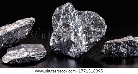 Chrome elemental specimen sample isolated on black background, mining and gemstone concept.