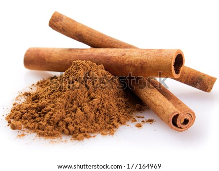 cinnamon sticks with powder isolated on white background #177164969