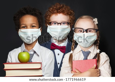 Children in protective face mask on black background, back to school and covid-19 concept Royalty-Free Stock Photo #1771966619