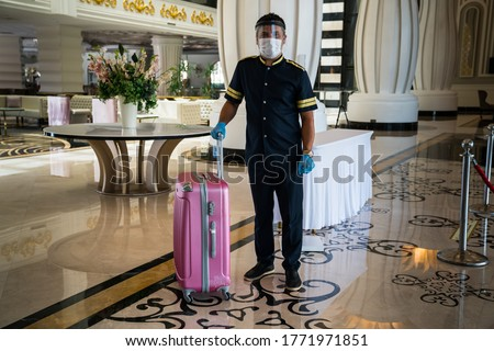 Face mask protection against pollution, virus covid-19, flu and (coronavirüs, pandemic). Medical mask isolated for hotel bellboy  Royalty-Free Stock Photo #1771971851
