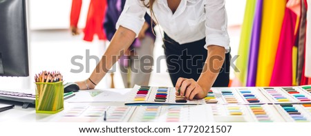 Portrait of young beautiful pretty woman fashion designer stylish stand and working with color textile samples.Attractive  senior woman working with mannequins and colorful fabrics at fashion studio Royalty-Free Stock Photo #1772021507