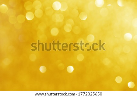 glitter light sparkle yellow golden gorgeous bokeh defocused abstract background shiny. Royalty-Free Stock Photo #1772025650