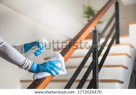 Deep cleaning for Coronavirus disease prevention. alcohol,disinfectant spray on Wipes of Banister in home for safety,infection of Covid-19 virus,contamination,bacteria that are frequently touched Royalty-Free Stock Photo #1772026670