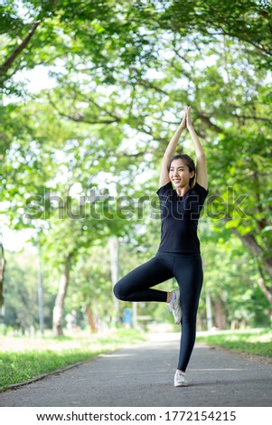Asian women are doing yoga in the park to keep them healthy and in good shape.