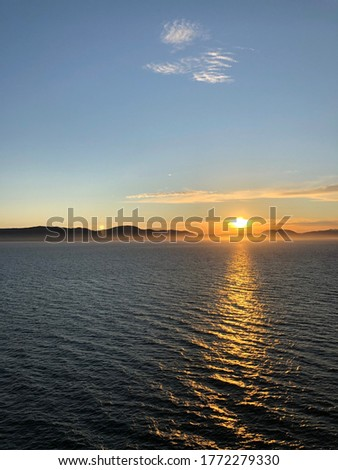 A Picture of a sunset in alaska from a cruiseship