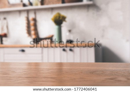 Wood table top (as kitchen island) on blur vintage kitchen background - can be used for display or montage your products