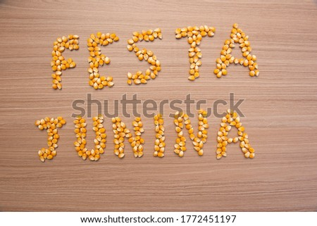 June party (Festa Junina) written with corn grains on wood. June party is a traditional Brazilian festival celebrated between June and July. Country party. #1772451197