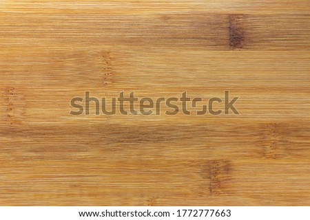 Texture Of Wooden Board Made Of Bamboo. Background Photo Of Texture Of Wooden Chopping Board Made Of Bamboo. Kitchen cutting Board made of bamboo. Board made of natural bamboo wood. Copy space #1772777663
