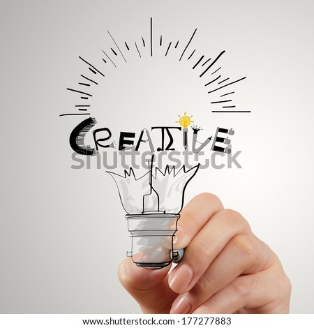 hand drawing light bulb and CREATIVE word design as concept