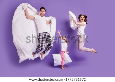 Full length body size view of cheerful glad carefree funny family small little daughter jumping having fun bedtime weekend isolated on bright vivid shine vibrant violet color background Royalty-Free Stock Photo #1772781572
