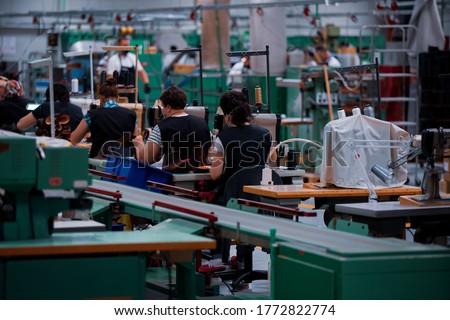 Shoe making process in footwear handmade  factory. Pandemic covid-19 virus. Royalty-Free Stock Photo #1772822774