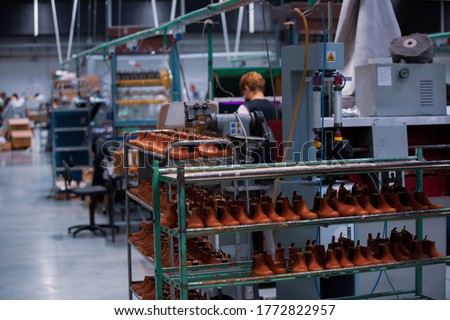 Shoe making process in footwear handmade  factory. Pandemic covid-19 virus. Royalty-Free Stock Photo #1772822957
