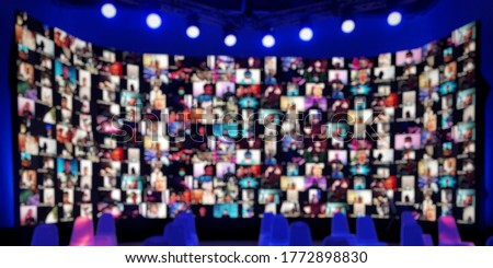Blurred wide LED screen of many people faces join big online  event or live conference.Video online conference.Social distancing  reduce risk coronavirus.New normal event production.Online seminar. Royalty-Free Stock Photo #1772898830