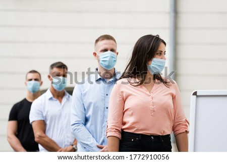 Job Center Line Of Jobless Unemployed Recruitment Seekers With Face Masks Royalty-Free Stock Photo #1772910056