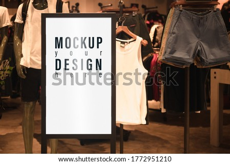 Mockup blank white screen sale advertisement billboard lightbox mockup. Poster advertisement light board mock up infront of male fashion shop.