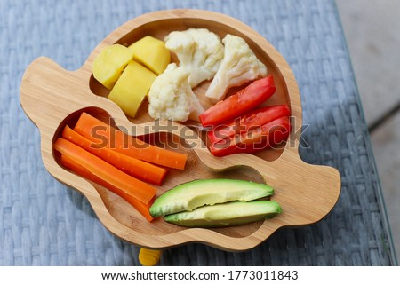 Top view of mix vegetable plate carrot,avocado,tomato, cauliflower and potato preparing for kid finger food self-feeding baby led weaning or BLW. #1773011843