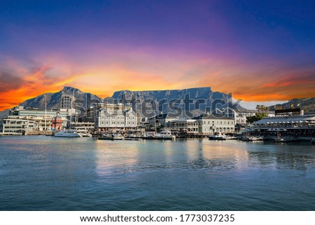 Table mountain waterfront boats and shops in Cape Town South Africa Royalty-Free Stock Photo #1773037235