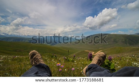 A man rest in the mountaing. Landscape with sky and valley #1773188681