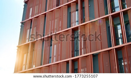 Modern apartment buildings on a sunny day with a blue sky. Facade of a modern apartment building. Glass surface with sunlight. #1773255107