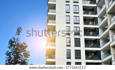 Modern apartment buildings on a sunny day with a blue sky. Facade of a modern apartment building. Glass surface with sunlight. #1773263117