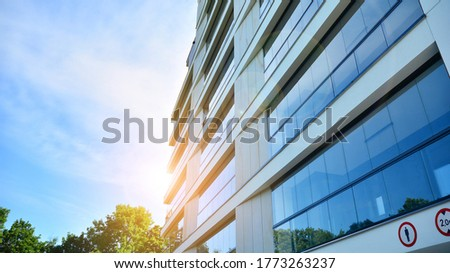 Modern apartment buildings on a sunny day with a blue sky. Facade of a modern apartment building. Glass surface with sunlight. #1773263237