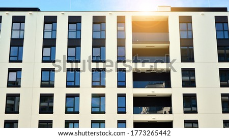 Modern apartment buildings on a sunny day with a blue sky. Facade of a modern apartment building. Glass surface with sunlight. #1773265442