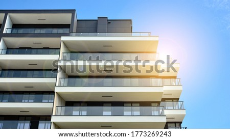 Modern apartment buildings on a sunny day with a blue sky. Facade of a modern apartment building. Glass surface with sunlight. #1773269243