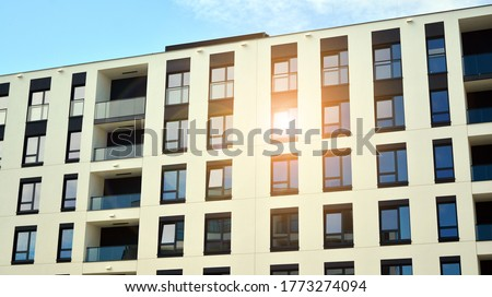 Modern apartment buildings on a sunny day with a blue sky. Facade of a modern apartment building. Glass surface with sunlight. #1773274094
