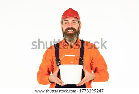 Decoration and decor. Wall painter with paint bucket. Hipster painter. Painters work. Apply plaster in order to finish interior walls. Bearded mature man painter. Construction and renovation. #1773295247