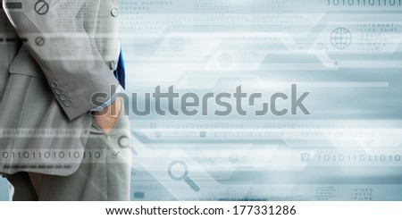 Bottom view of confident businessman against media background #177331286