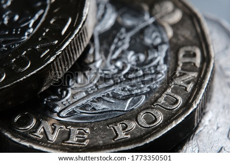"British one Pound coin. The word ""One Pound"" in a main focus. Macro. Selective focus. Concept. Royalty-Free Stock Photo #1773350501"