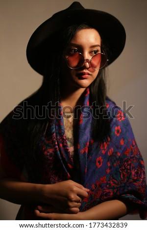 portrait filipino woman using hat and glasses. woman filipino with hat