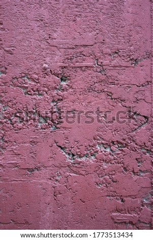 Cracked concrete wall painted with burgundy paint. Peeled burgundy paint on a concrete wall. Cracked concrete texture painted in burgundy. The burgundy red paint of an old cracked background. Purple. #1773513434