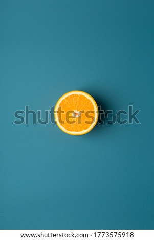 Orange fruit at blue background as minimal picture. Concept of harvest fresh fruit food. Minimal frame for text at market sale