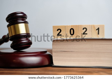 The concept of new laws in 2021 next to the judge hammer. #1773625364