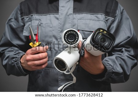 CCTV Installation Wizard concept. Service for installing CCTV cameras. Royalty-Free Stock Photo #1773628412