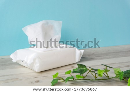 Wet tissue on the table Royalty-Free Stock Photo #1773695867