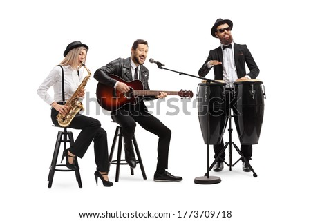 Man playing an acoustic guitar, female sax player and a man conga drummer performing in a band isolated on white background Royalty-Free Stock Photo #1773709718