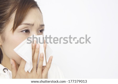 Japanese woman blowing nose #177379013