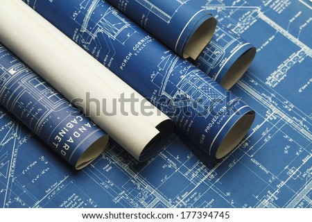 Rolled House Blueprints and Construction Plans. Royalty-Free Stock Photo #177394745