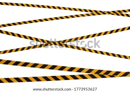 Black and yellow lines of barrier tape prohibit passage. Barrier tape on white isolate. Barrier that prohibits traffic. Warning tape. Danger unsafe area warning do not enter. Concept of no entry #1773953627