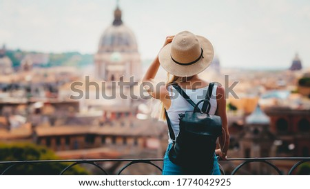 Rome Europe Italia travel summer tourism holiday vacation background -young smiling girl with mobile phone camera and map in hand standing on the hill looking on the cathedral Vatican Royalty-Free Stock Photo #1774042925