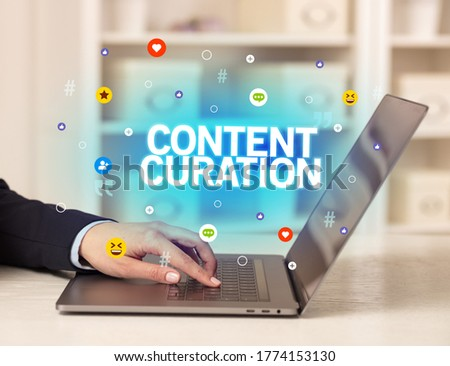 Freelance woman using laptop with CONTENT CURATION inscription, Social media concept