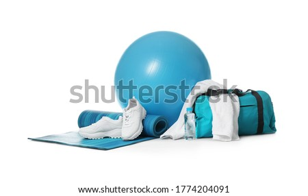 Fitness ball, gym bag and sport accessories isolated on white Royalty-Free Stock Photo #1774204091