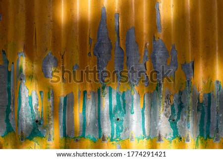 The surface of the old galvanized sheet. Old galvanized sheet background. Yellow. For backdrop,wallpaper,background.